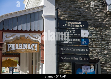 arrowtown pharmacy and signpost,new zealand - Stock Photo
