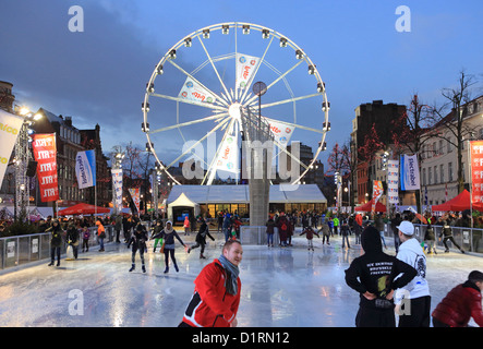 The ice skating rink and big wheel on Fish Market Place, in St Catherine's Christmas market, in Brussels, Belgium - Stock Photo