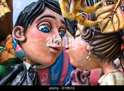 Couple kissing on a Carnival Float during a famous and Traditionsl Carnival Padare in Putignano 2012, Bari, Apulia, - Stock Photo