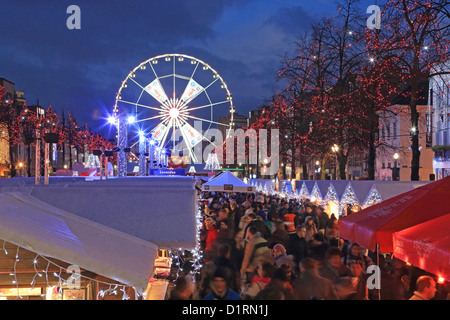 The Christmas market and big wheel in St Catherine's Place on the Fishmarket, part of Brussels Winter Wonders, in - Stock Photo