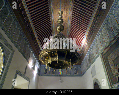 Decorative ceiling of cedar wood and mosaic tiles, plus chandelier, in Dar Si Said museum of Moroccan Arts, Marrakesh - Stock Photo