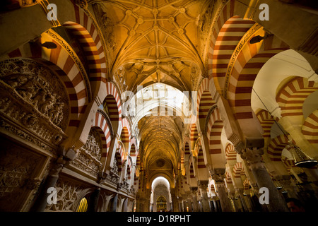 Interior of the Mezquita Cathedral ( The Great Mosque) with both Christian and Islamic architectural styles in Cordoba, - Stock Photo