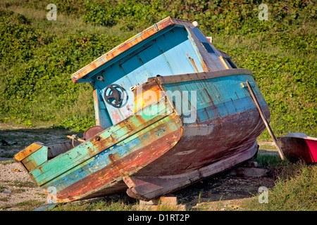 An old abandoned fishing boat on the shores of Barbados. - Stock Photo