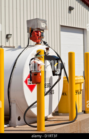 Environmentally safe industrial fuel tanks with safety features such as fire extinguishers and back up pillars. - Stock Photo
