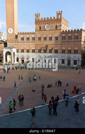 The Piazza del Campo, Torre del Mangia and The Museo Civico in the Palazzo Pubblico, the Town Hall - in Siena, Tuscany, - Stock Photo