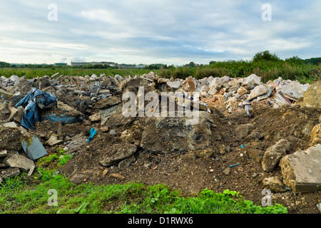 Fly tipping. Illegal dumping of construction waste on farmland, Nottinghamshire, England, UK - Stock Photo