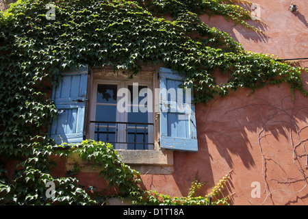 Colorful houses in Roussillon in the Luberon, Provence, France - Stock Photo
