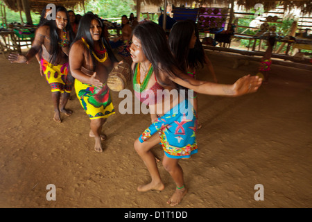 Embera Puru indian woman performing a dance in the Embera Puru village beside Rio Pequeni, Republic of Panama. - Stock Photo