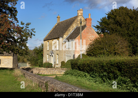 Cotswold cottage in Late Summer - Stock Photo