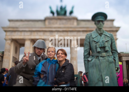 Berlin, Germany, tourists and a living statue in front of the Brandenburg Gate