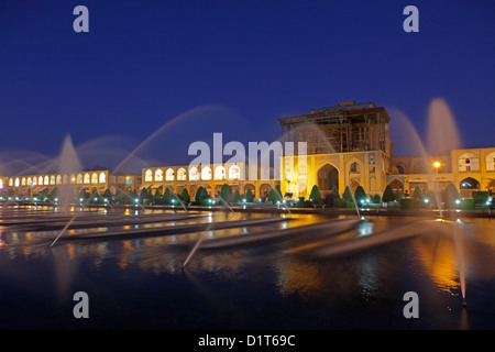 Ali Qapu palace at dusk in Naqsh-e Jahan Square, Isfahan, Iran - Stock Photo