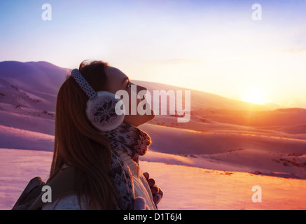 Image of pretty woman walking in snowy mountains, side view of cute girl looking up, closeup portrait of female - Stock Photo