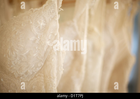5835220820 New wedding dresses hanging on a rack in wedding dress shop! - Stock Photo