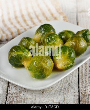 Roasted Brussels Sprouts In A White Dish - Stock Photo