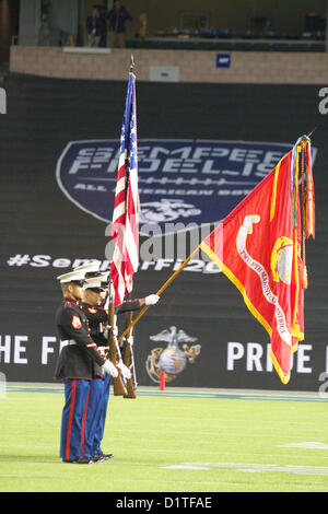 A Marine Corps Color Guard presents the national colors during the National Anthem at the start of the Semper Fidelis - Stock Photo