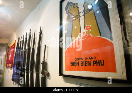 HANOI, Vietnam - At right is a propaganda poster celebrating the Vietnamese victory over the French in 1954 at Dien - Stock Photo