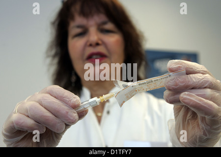 Berlin, Germany, nurse prepares a syringe for vaccination against swine flu - Stock Photo