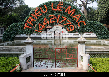 HANOI, Vietnam - A sign for Trieu Le-Mac over the gate to a small lake at The Temple of Literature in Hanoi, Vietnam. - Stock Photo