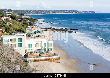 Malibu- Modern houses overlook ocean and waves by El Matador state beach in Malibu, California - Stock Photo