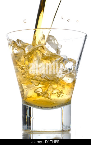 Splash of whiskey on the rocks stock photo - Stock Photo