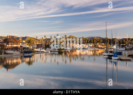 Sunrise at residential development by water in Ventura, California with modern homes and yachts boats - Stock Photo