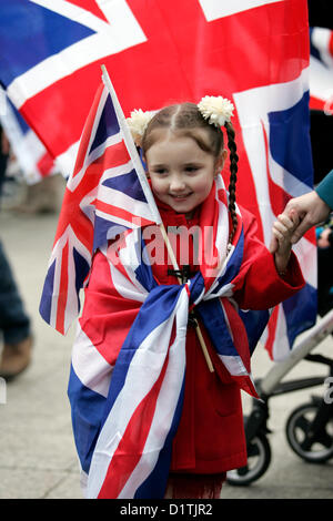 Belfast, UK. 5th Jan, 2013.A young girl adorned with Union Jack flags attends the ongoing flag protests. the protest - Stock Photo