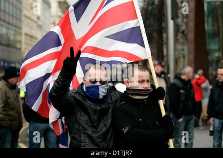 Belfast, UK. 5th Jan, 2013. Two men with scarves partially hiding their faces were at the flag protests which took - Stock Photo