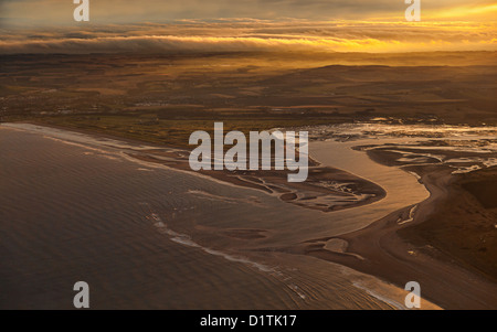 Aerial view over St Andrews, the Golf Course and West Sands with the light shining through the low level clouds - Stock Photo
