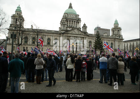 Belfast, UK. 5th Jan, 2013. PSNI officers in Riot gear follow Loyalist protesters as they leave Belfast city centre - Stock Photo