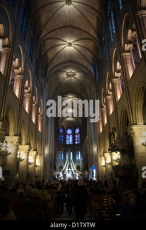 Main nave inside Notre Dame de Paris cathedral - Paris, France - Stock Photo