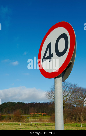 UK 40mph speed limit sign on a country road - Stock Photo