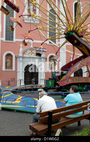 Pruem, Germany, funfair and St Saviour's Basilica - Stock Photo