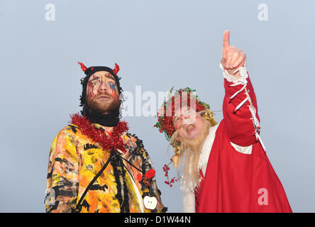Bankside, London, UK. 6th January 2013. Beelezebub and Father Christmas performing the Mummers Play. Twelfth Night - Stock Photo