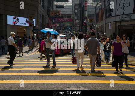Busy Pedestrian Crossing at the Junction of D'aguilar Street and Queen's Road, Hong Kong Island - Stock Photo