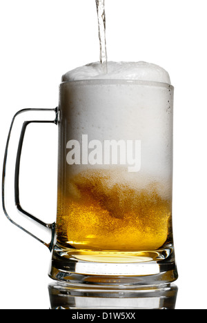 Pouring a light beer in a transparent keg isolated on white - Stock Photo