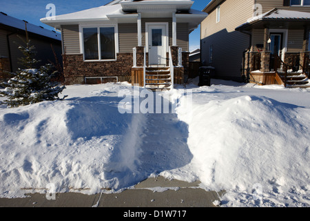 house with path cleared of snow leading to front porch Saskatoon Saskatchewan Canada - Stock Photo