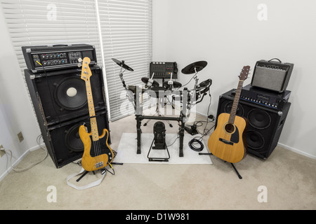 Rock band practice set up inside a modern suburban home. - Stock Photo