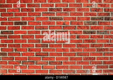 a red brick wall background backdrop pattern wallpaper - Stock Photo