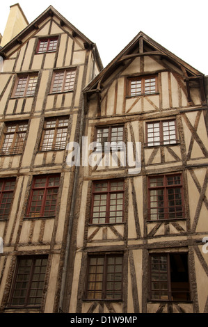 This pair of medieval half-timbered houses in the fashionable Marais district of Paris are very old, and may date - Stock Photo