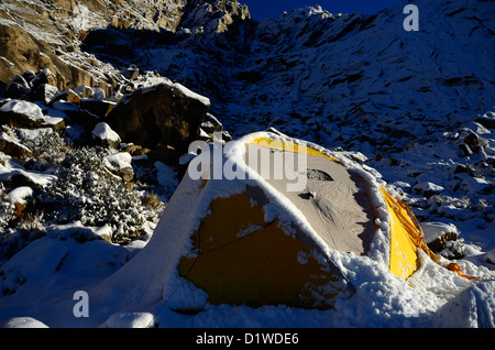 A snow covered mountaineering tent in the Cordillera Blanca mountains - Peru - Stock Photo