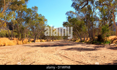 Dry sandy creek bed in the East MacDonnell Ranges, Central Australia - Stock Photo