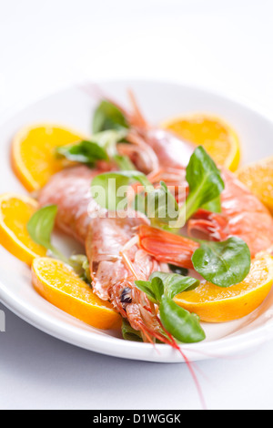Pacific shrimps salad with orange slices close up - Stock Photo