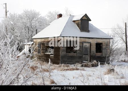 derelict empty wooden traditional house in rural village Forget Saskatchewan Canada - Stock Photo