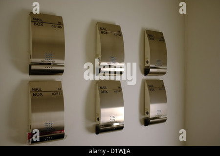 stainless steel letter/mail boxes in the entrance to the luxury appartments in the Royal Phuket Marina Thailand - Stock Photo
