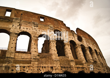 The Roma Colosseum, by a cloudy day (wide angle) (HDR-like picture) - Stock Photo