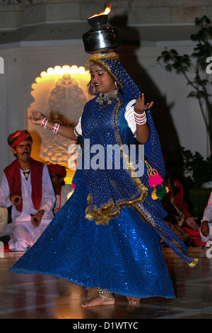 A colourful Rajasthani dancer performing a traditional folk dance at the Lake Palace Hotel in Udaipur, Rajasthan, - Stock Photo