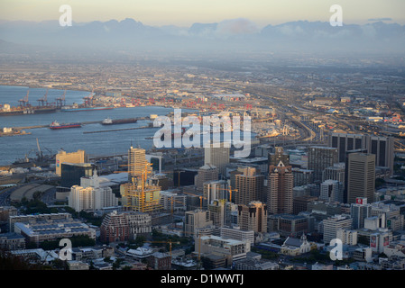 Evening aerial shot of Cape Town city centre, harbour and Hottentots Holland  mountains in background. - Stock Photo