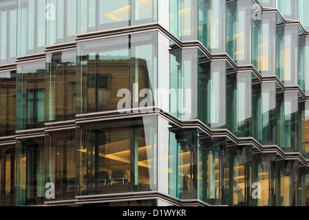 Modern office building with large glass windows for walls in Berlin city, Germany, Europe. - Stock Photo