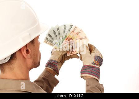 Construction worker counting money _ from behind - Stock Photo