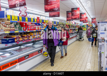 People shopping for food in the days before Christmas, Lidl supermarket, UK - Stock Photo